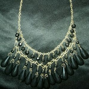 Jewelry - Black beads on a gold color chain
